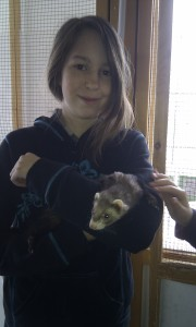 Maret with a ferret at the pet store she frequented Spring/Summer 2012