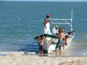 boys hanging on boat