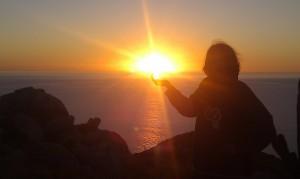 Maret holding the rising sun