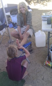 a little like primates....Laars picking slivers or peeling skin off Mitchell's feet.