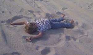Laars making a sand-angel