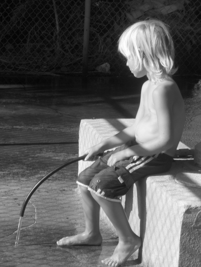 Laars playing with a hose