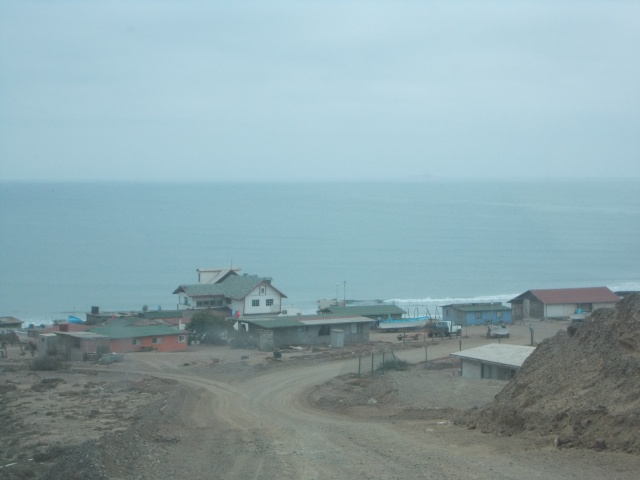 view as we drove down into the fish camp.  We were surprised at how many permanent houses there were.  Unusual from what we've seen.