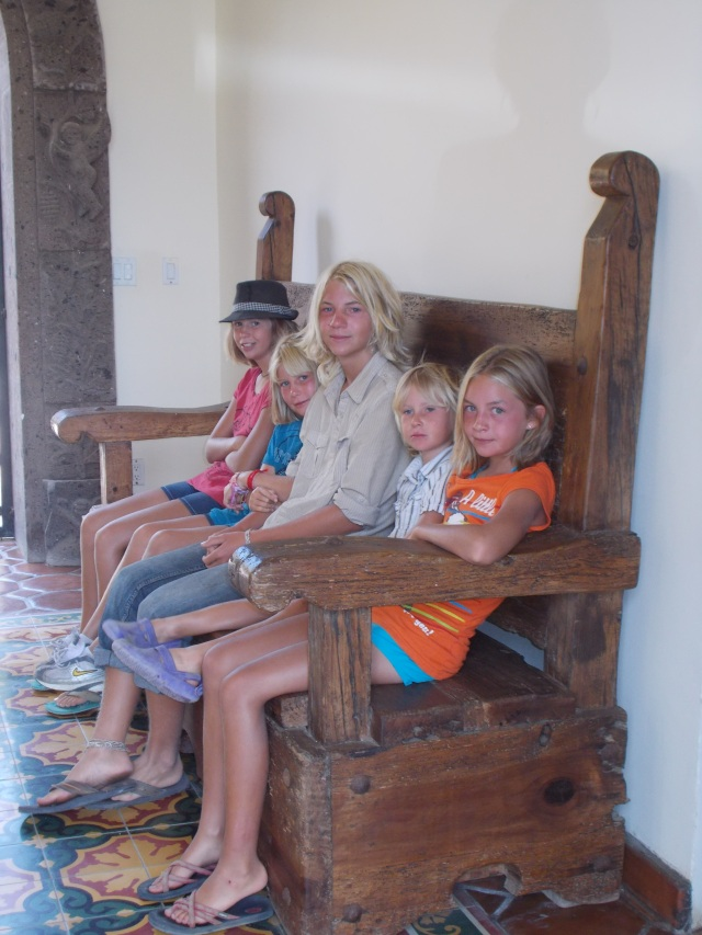 5 kids on the big bench at the entrance