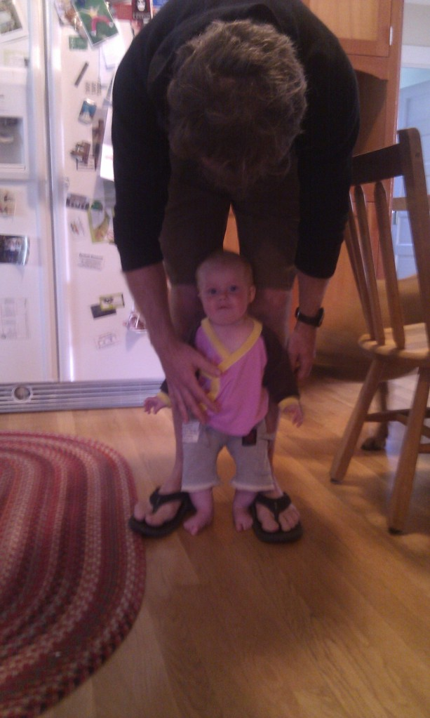 Standing with her daddy