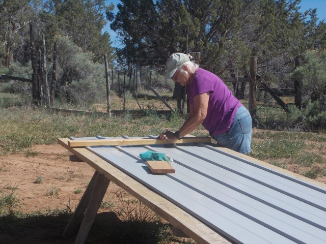 Ann cutting the tin sheeting for the guys