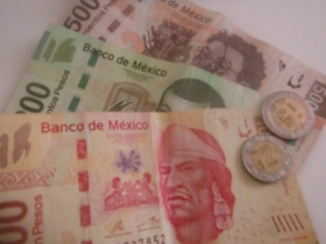 Mexican money.  Pesos, a bit reminiscent of Canadian 'play money'.  Each bill is not only a different colour, but they are different in length!