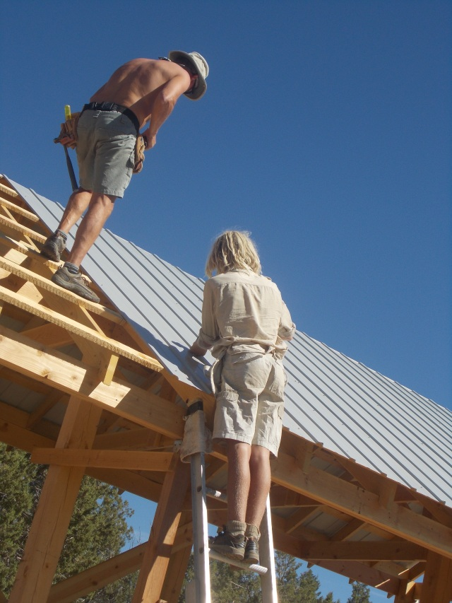 Putting up the rest of the tin roof