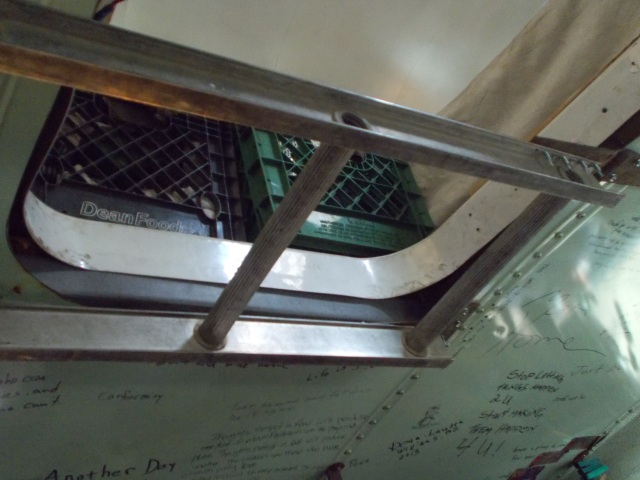 magnetic ladder attached to the roof, lowers to get up to his bedroom.