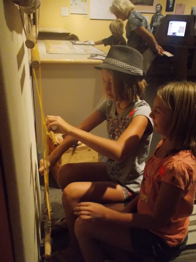 Ann first taught Tov how to use the loom, then Tov spent time teaching Maret and others to weave and this became one of their #1 favourite activities to do at this museum.
