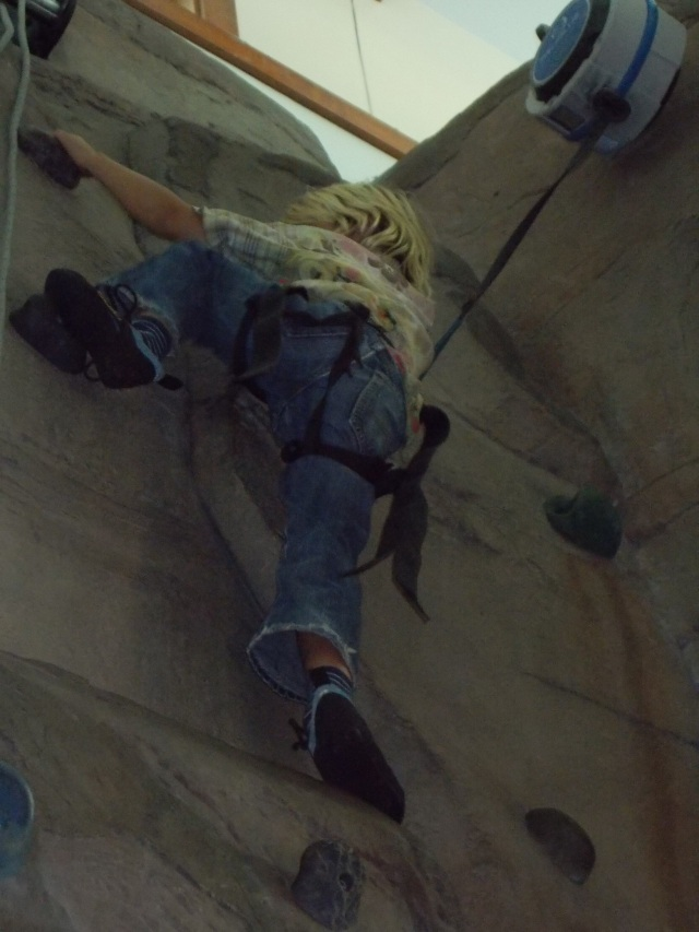 Anders making a stretch to reach the next foothold