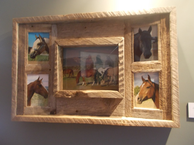 I loved the frame.  Made from reclaimed 100 year old barn wood.  The side photos were slanting inwards while the middle photo was flat.