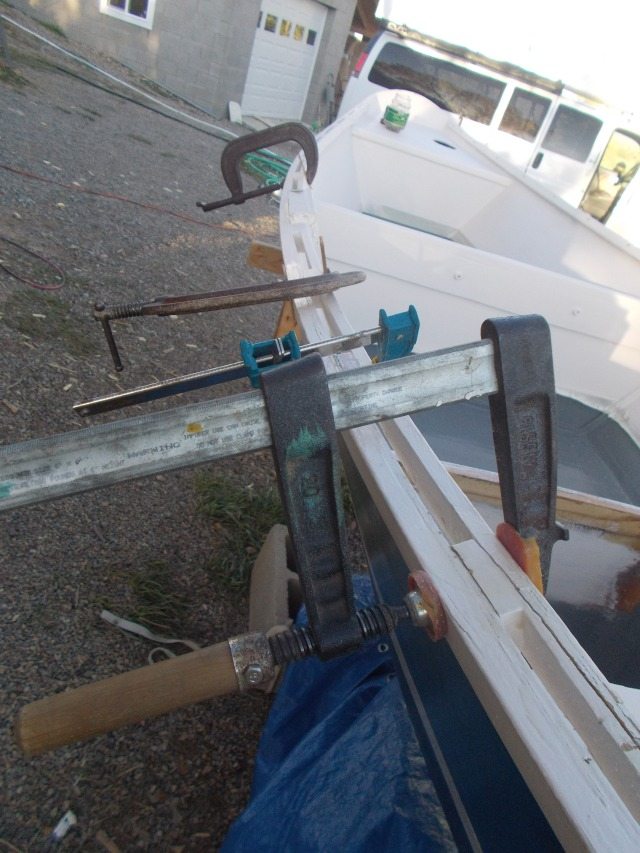 Clamped at all the cracked areas.  Much of it was just cracks in the resin, not the wood.