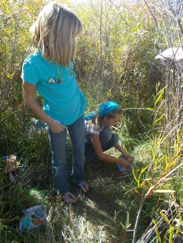 Gaelyn, Tov & Laars' fort stamped out of the tall grass.