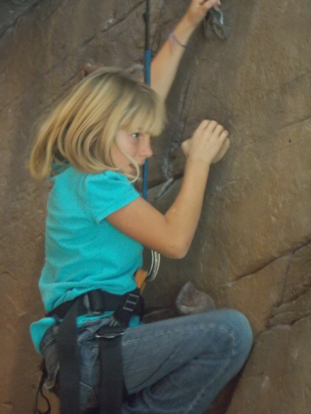 Gaelyn finds this very challenging.  Just getting her feet on the holds one row from the ground is thrilling for her.