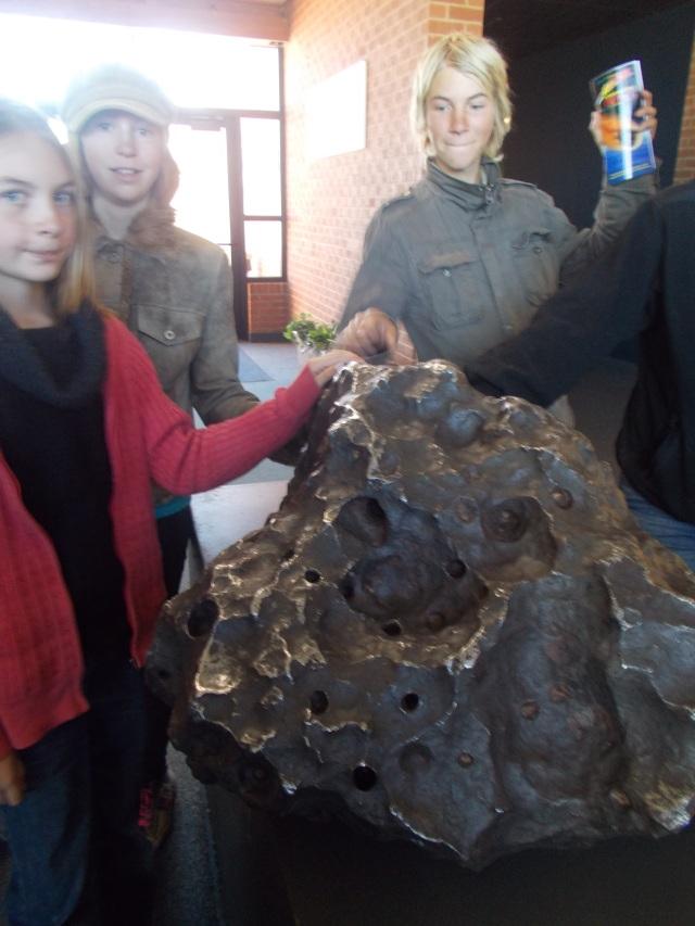 Kids touching the Holsinger meteorite weighing 1,406 lbs