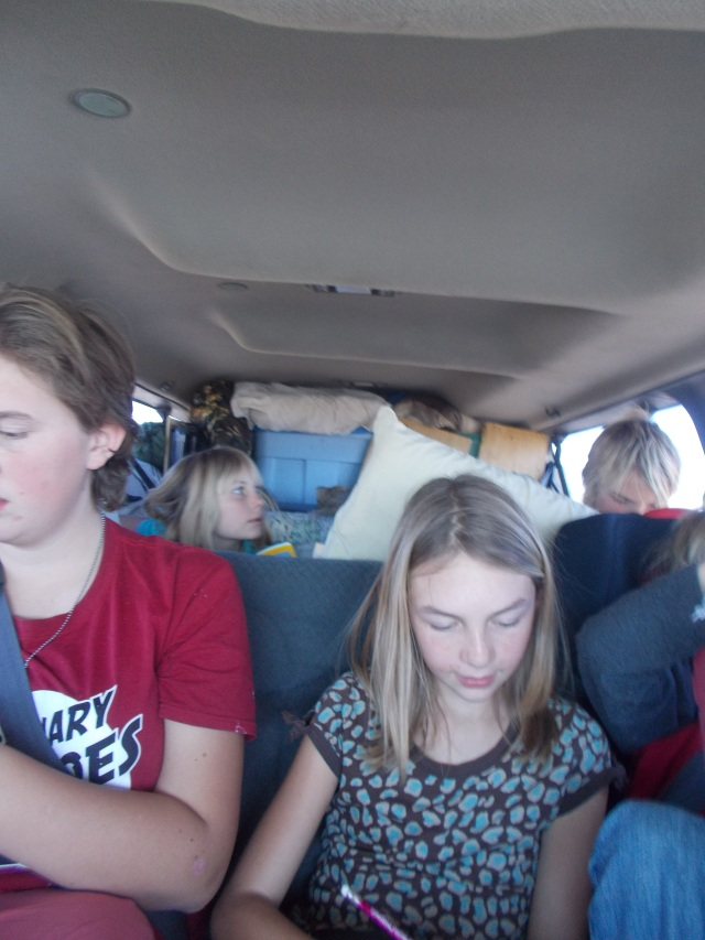 Inside van while we are traveling.  Kids mostly surrounded by blankets, pillows, extra jackets, soft stuff.