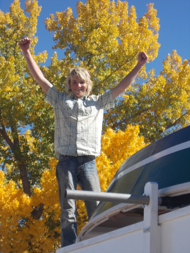 Love this photo of Mitchell.  Excited the boat is up, looking forward to adventures ahead.