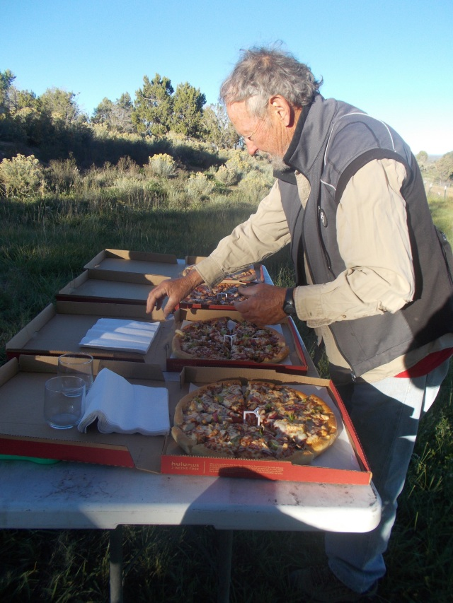Tim getting the pizza's all ready to be gobbled up