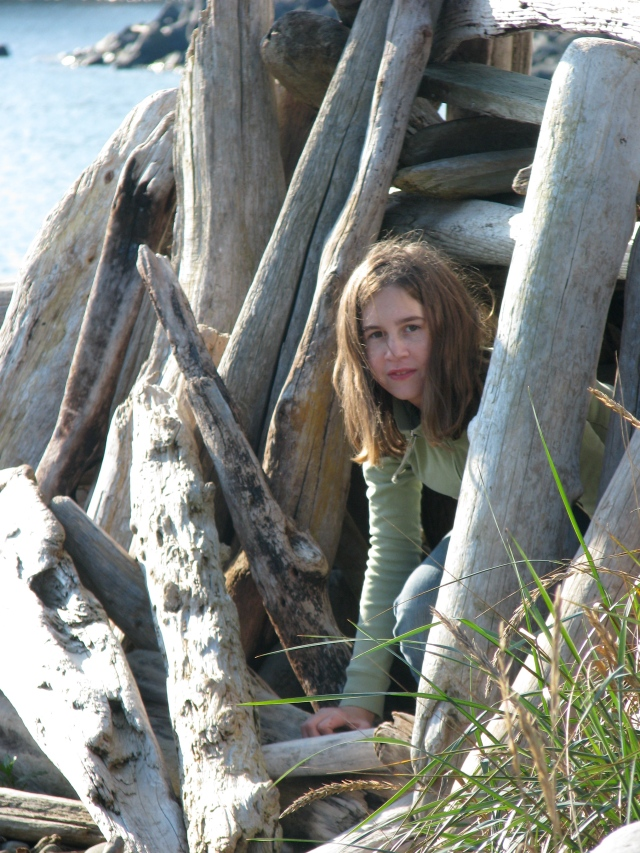 Danaka at the driftwood fort at Whiffen Spit, Sooke, BC.