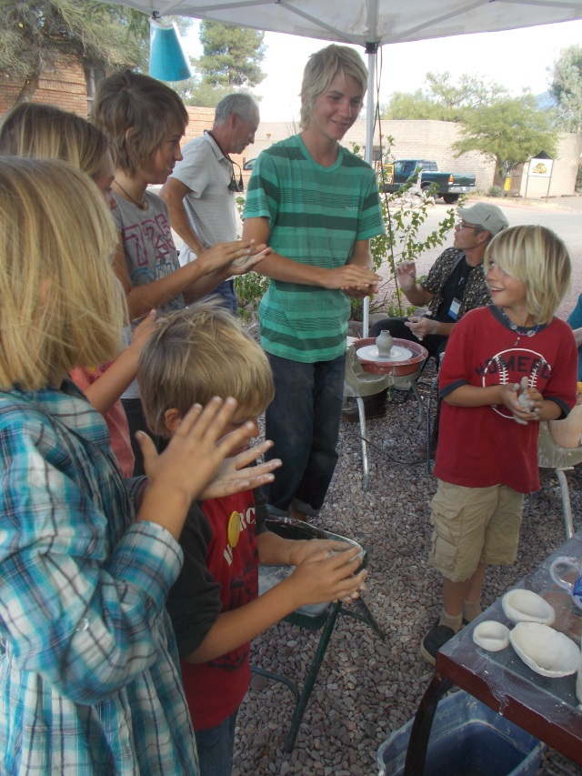6 kids rolled their balls of clay then made bowls, and later their own creations of turtles or whatever they wanted.
