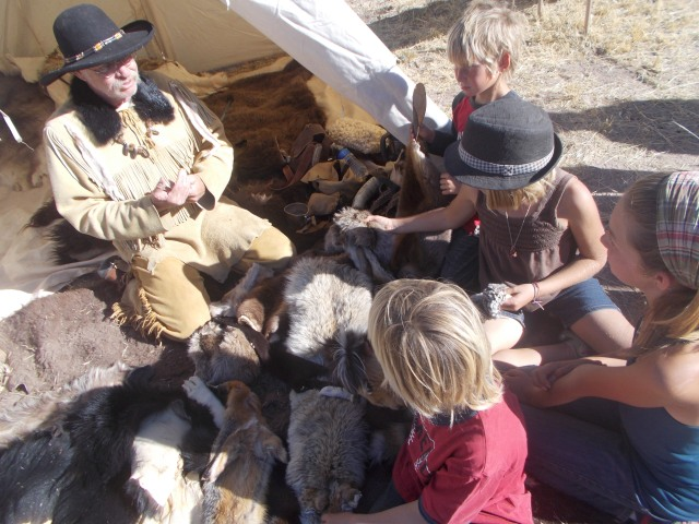 Another highlight of the younger 4 was the guy with all the furs.  We hung out there several times during the day.
