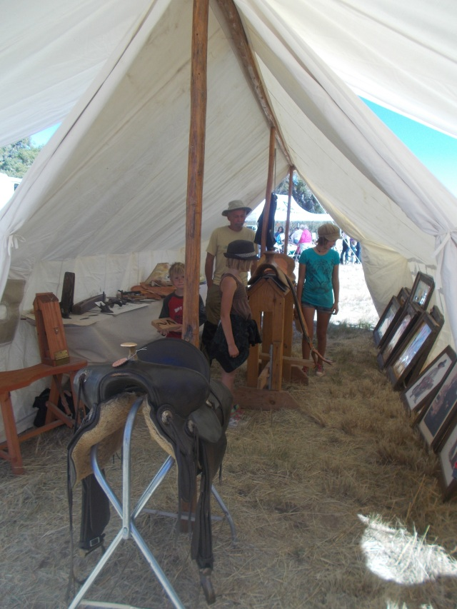 Art displayed inside an old-fashioned tent