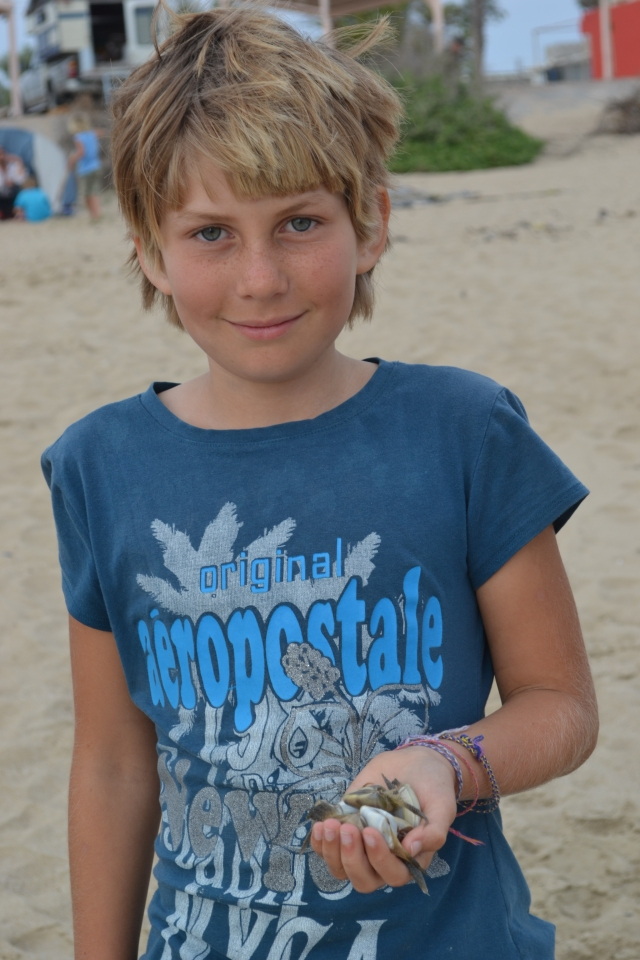 Gaelyn with a collection of beach-finds