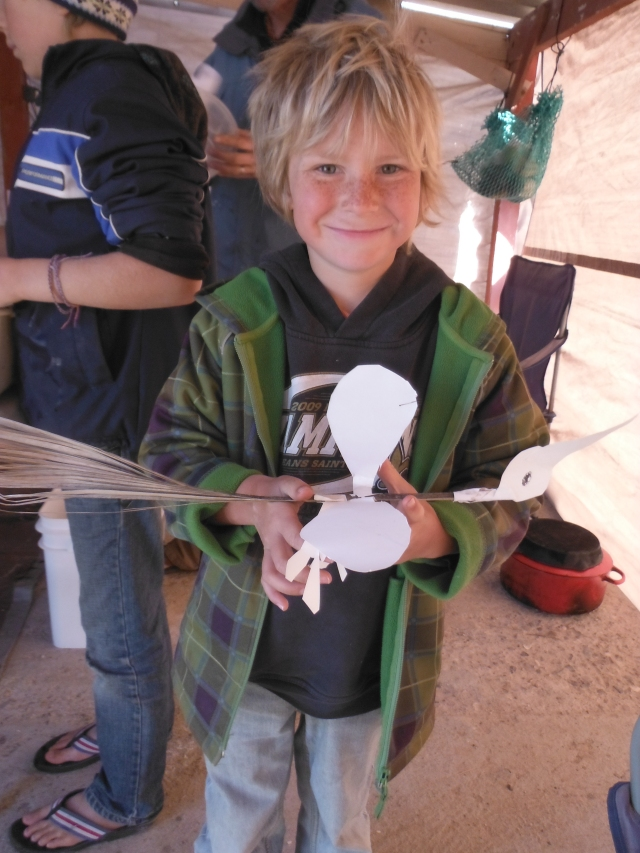 Laars built this bird from a dried palm frond for the tail, and paper wings, legs and head.  He insisted on a picture since we can't pack and carry all of his creations.  At least we can keep photos of them.