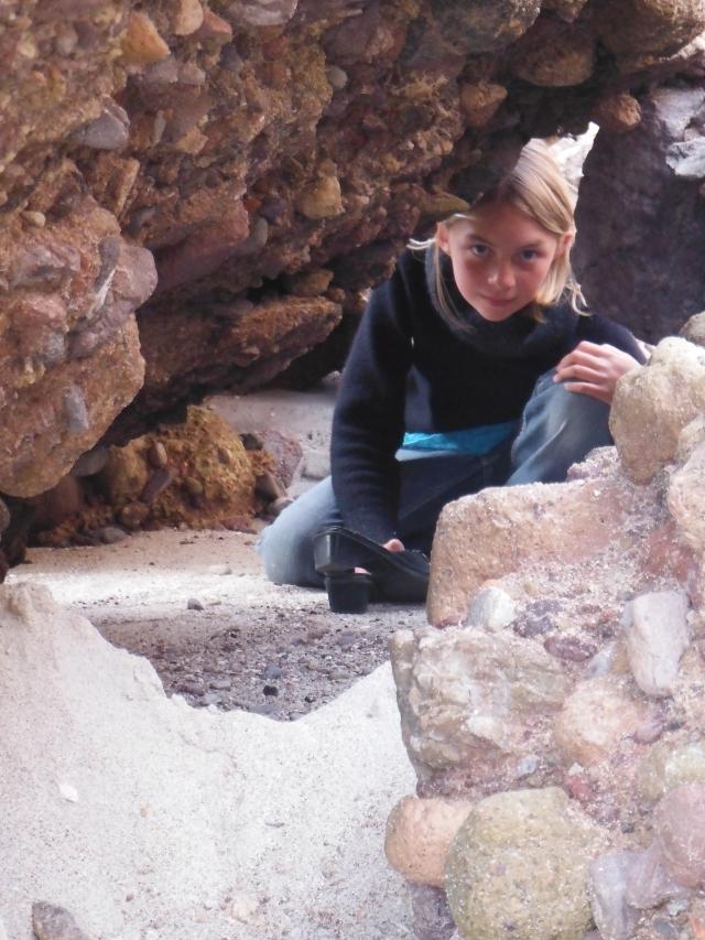 Toveli peeks Danaka's way between the rocks.