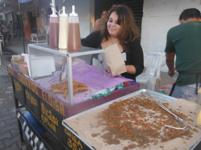 Dispensing churros.  You can get sauces added, but we enjoy them hot with sugar on them.  Plain and simple.