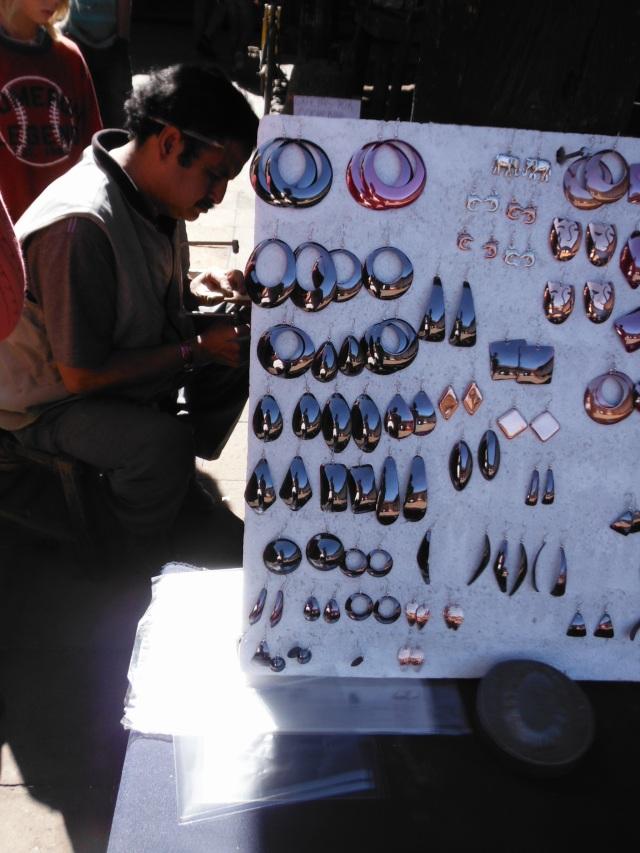 An artisan working on making jewellery.