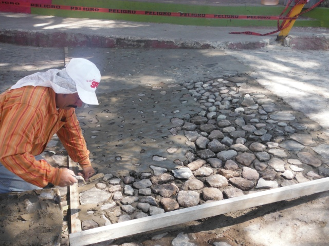 Laying cobblestones down by the Ajijic malecon.