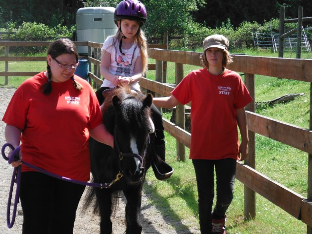 April and Maret taking school kids on Pony Rides