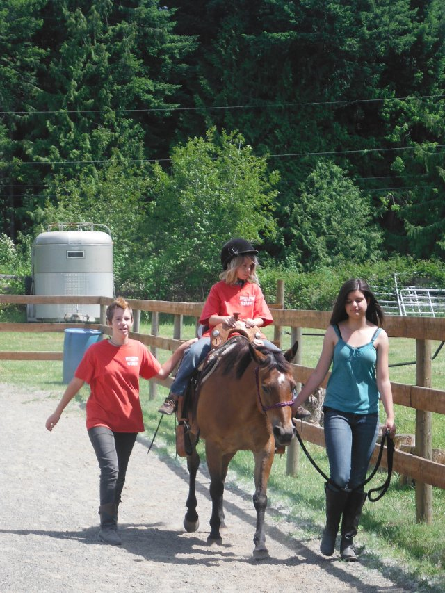 Annalee and Maret were paired up to do the Pony Rides together.  It was a quiet part of the day so Anders got a ride.