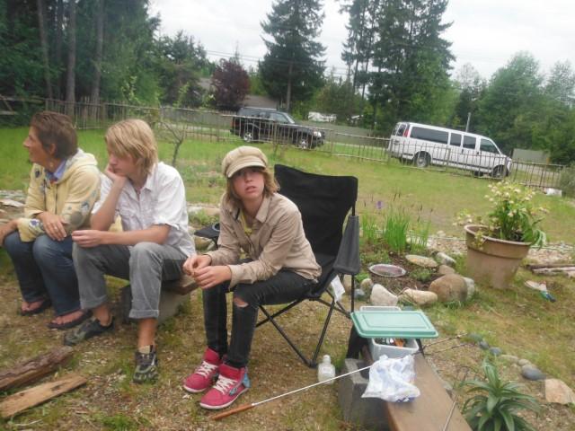 Karen, Mitchell and Maret around the campfire