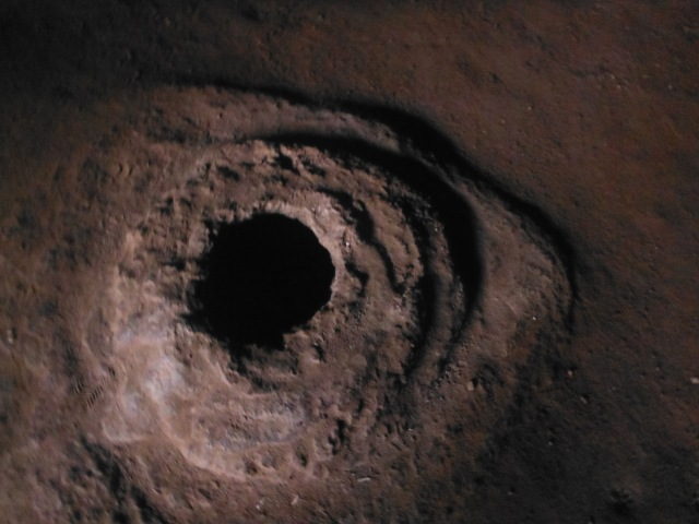 A volcanic tube in the floor of the cave.