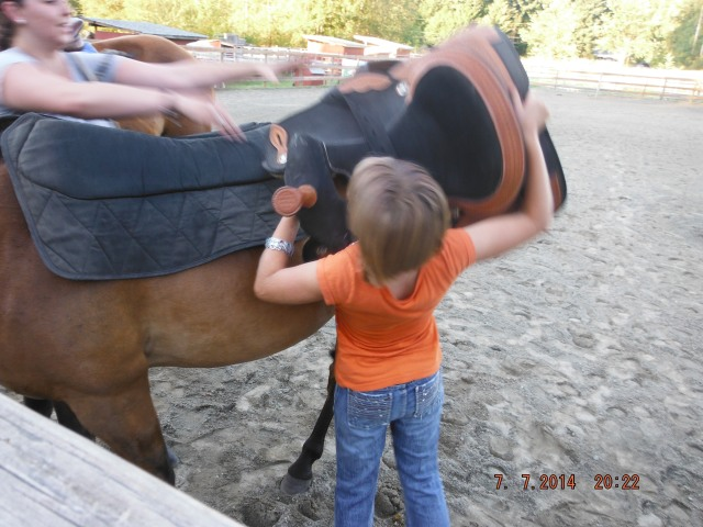 Keisha helping Gaelyn get the saddle up and over