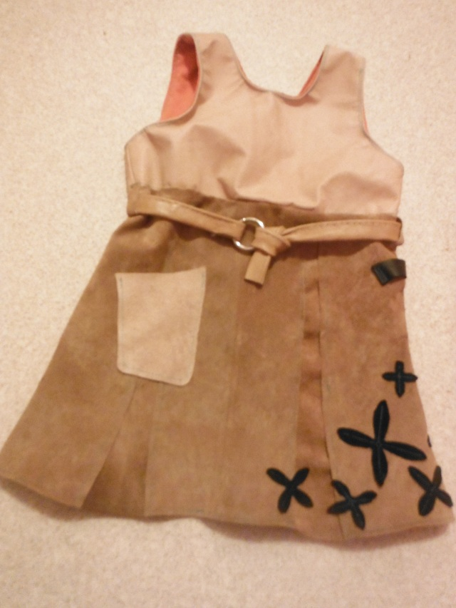M&M designed and sewed this leather dress for the other M in the family (Mitch/Maret/Marin).  A pocket for rocks and other finds, and a black strap to hold a hammer or a sword or whatever that little sweetie fancies.